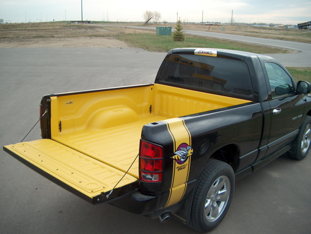 Truck Bedliner Sprayed with Yellow XTRA